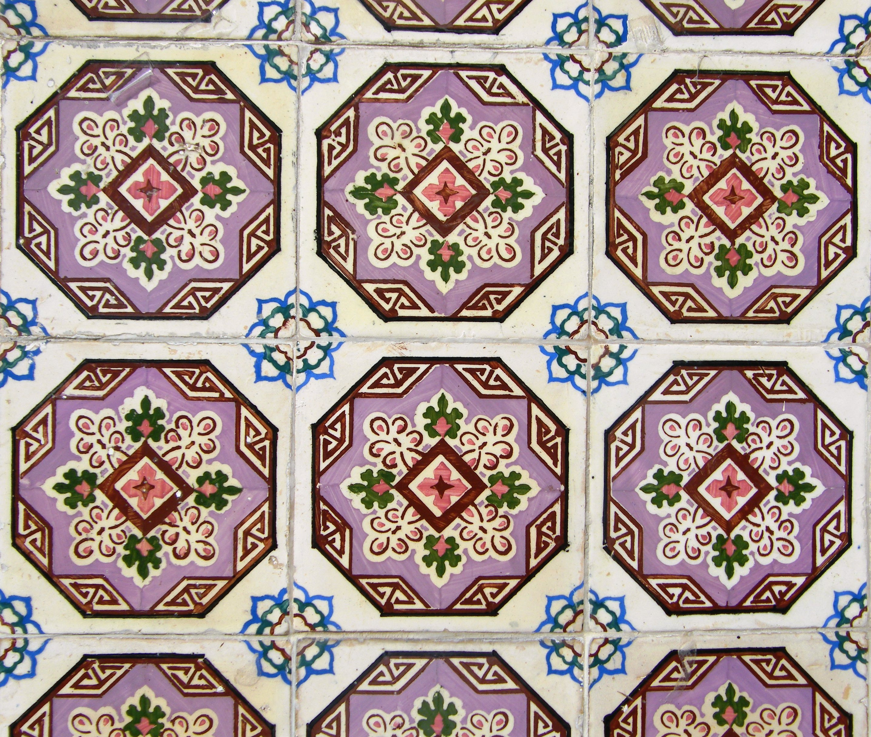Detail of late 19th century stencilled tiles on a facade in Coimbra