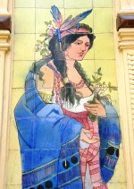 Detail of tile panel on a shopfront in Porto made by the local Carvalhinho Factory in 1917