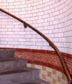 Staircase in Leeds City Markets with white glazed bricks and decorative tiles