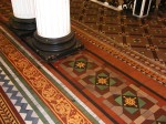 Hall way with encaustic tiles made by Maw & Co at the Leeds Club