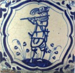 Early 17th century Dutch tile with a soldier playing on a flute
