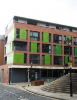 Crown Street Buildings built in 2004  situated behind the Corn Exchange. All the sides of the building are decorated with colourful faience.