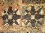 Detail of two inlaid tiles at Kirkstall Abbey