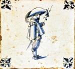 Mid 17th century Dutch tile with a soldier and fleur-de-lis corner motifs