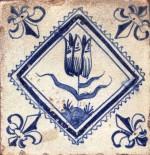 Mid 17th century Dutch tile with a tulip and fleur-de-lis corner motifs