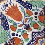 Early 17th century polychrome  Dutch tile with a complex motif of a tulip, marigolds, grapes and pomegranates