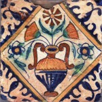 Early 17th century polychrome Dutch tile with marigolds in a vase and large 'reserve'(white on blue)  corner motifs