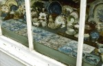 Delft tiles in the window of an antique shop in Cambridge