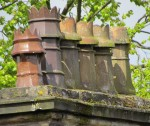 Stone stack with ceramic chimney pots  on almshouses at Wilshaw near Huddersfield, c, 1871