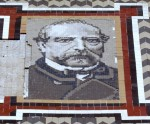Tiled portrait of Miguel Nolla on the facade of his house, the Palauet, next to his factory in Meliana.