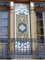 Detail of the facade of a house in Meliana dated 1905 decorated with Nolla tiles.