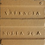 The reverse of a dust-pressed unglazed Nolla floor tile measuring 5 x 5 cm.