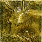 Press-moulded Burmantofts tile showing a donkey, c. 1885